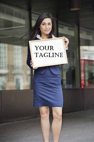 woman_holding_sign_your_tagline.jpg