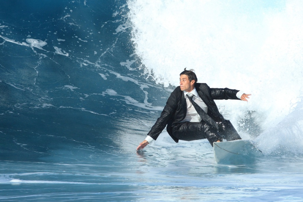 young-business-man-surfing-picture-id119807633